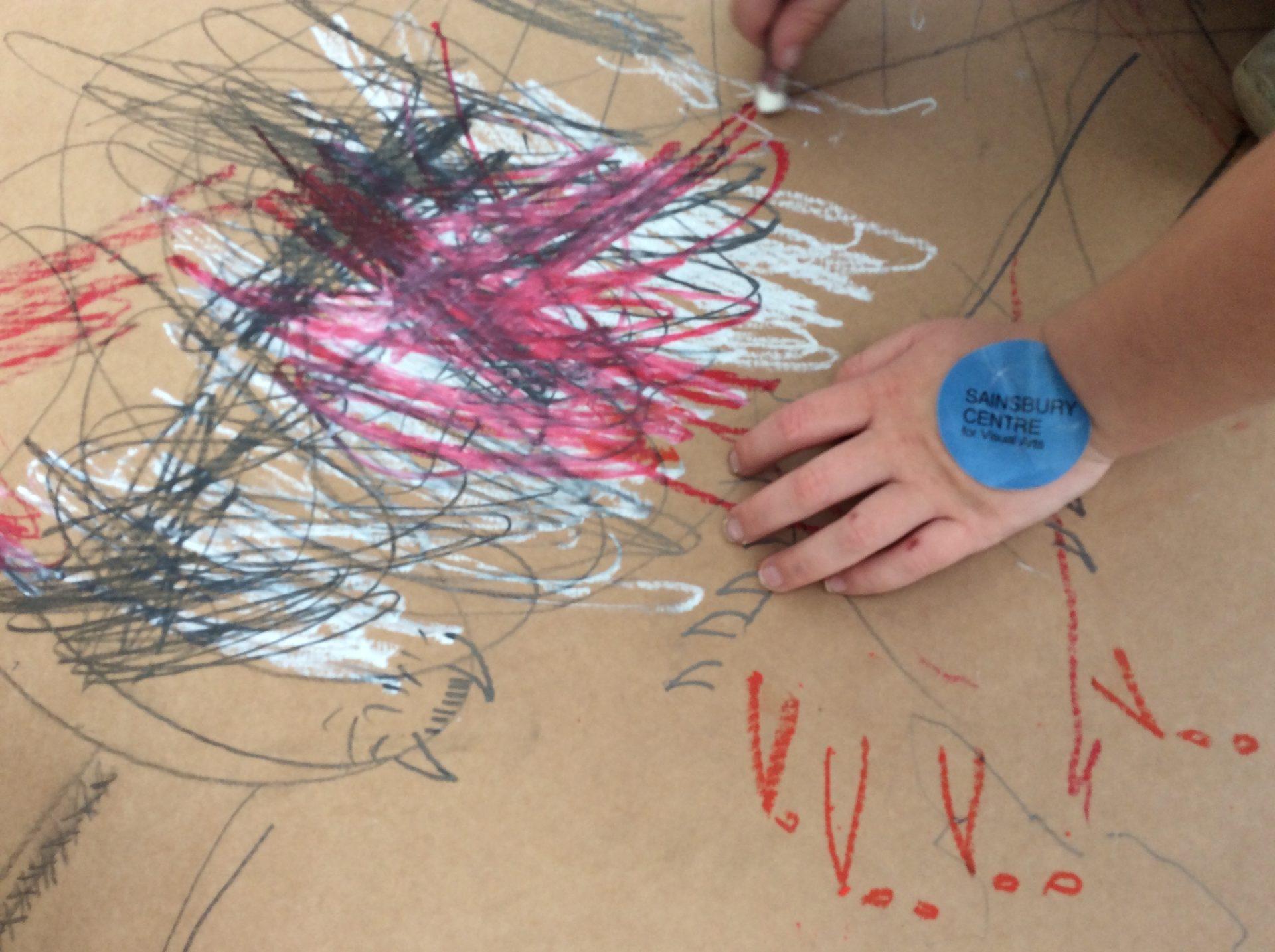 Child's hand, blue sticker, cardboard
