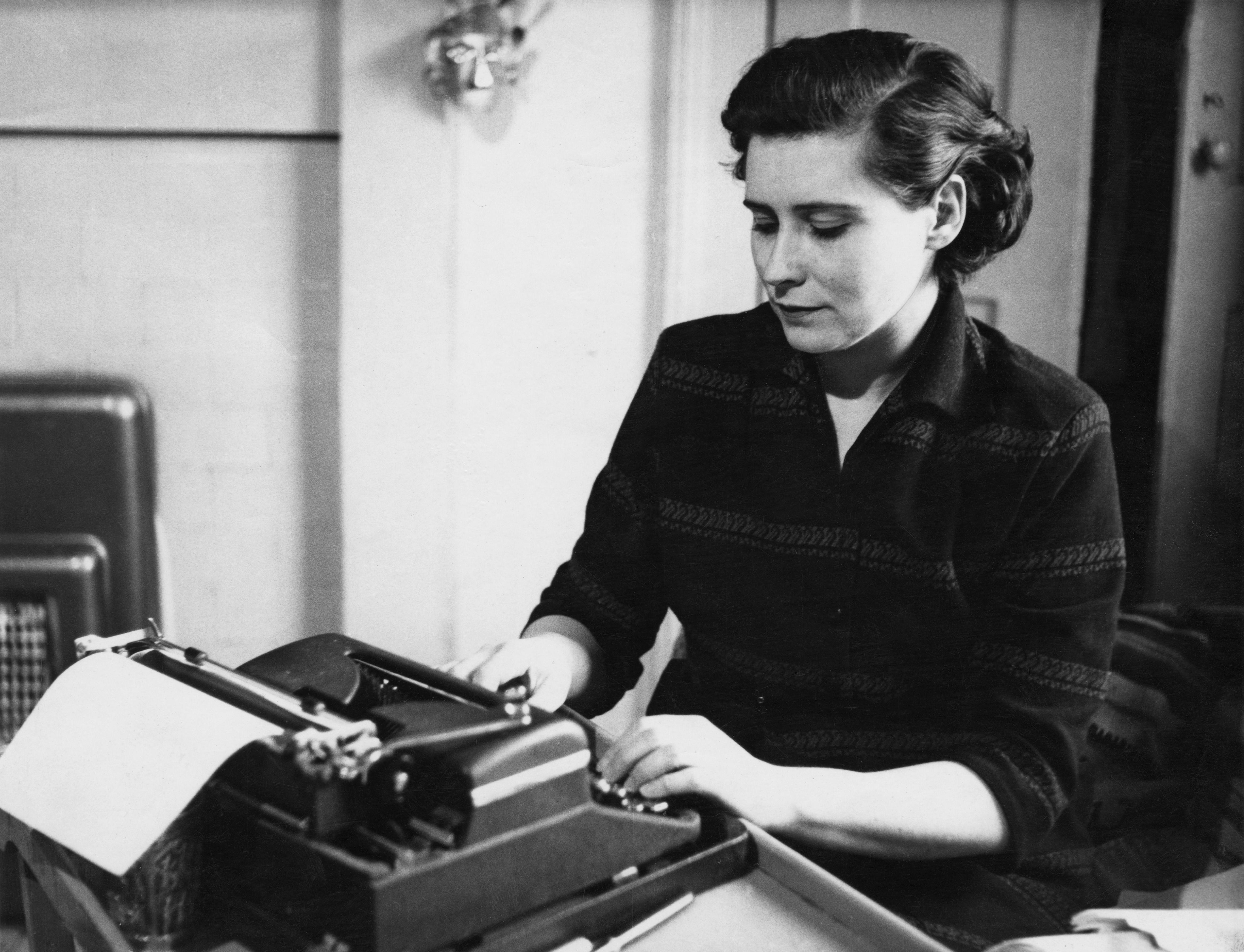 Doris Lessing at a typewriter